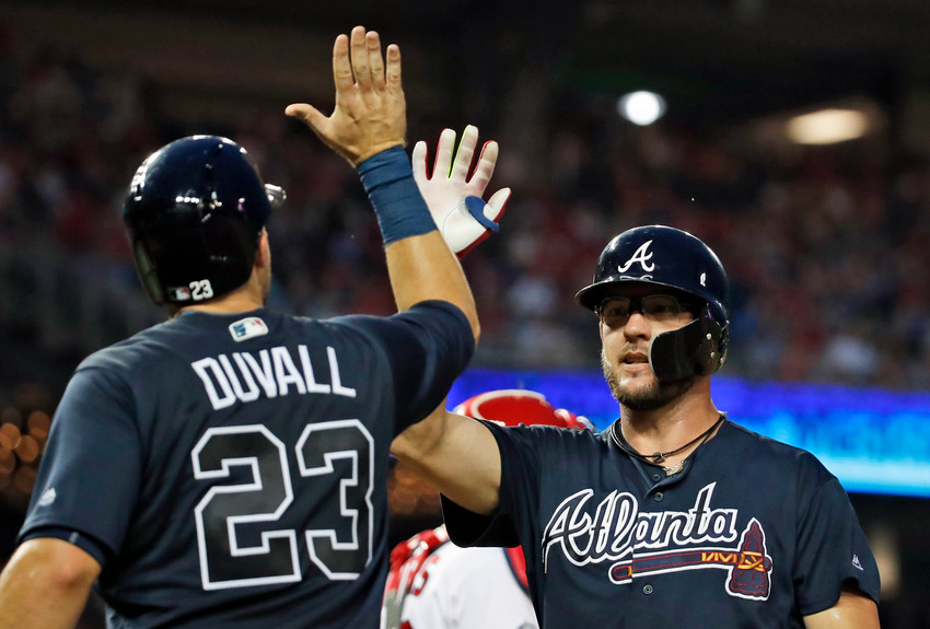 Atlanta Braves' Adam Duvall celebrates with Tyler Flowers after Flowers' two-run home run during the fourth inning of a baseball game against the Washington Nationals at Nationals Park, Wednesday, Aug. 8, 2018, in Washington. (AP Photo/Alex Brandon)