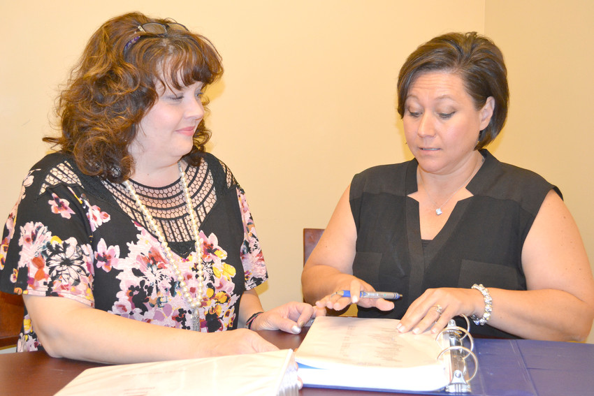 Tracy Plant, left, and Jennifer Wilkerson look over paperwork at the Upper Cumberland Children's Advocacy Center.