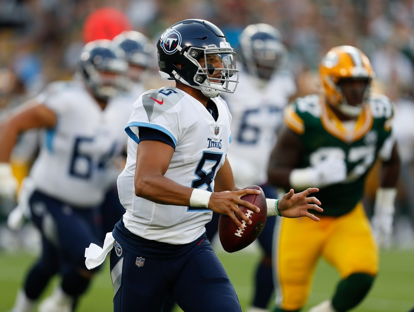Tennessee Titans quarterback Marcus Mariota scrambles during the first half of a preseason NFL football game against the Green Bay Packers Thursday, Aug. 9, 2018, in Green Bay, Wis. (AP Photo/Matt Ludtke)