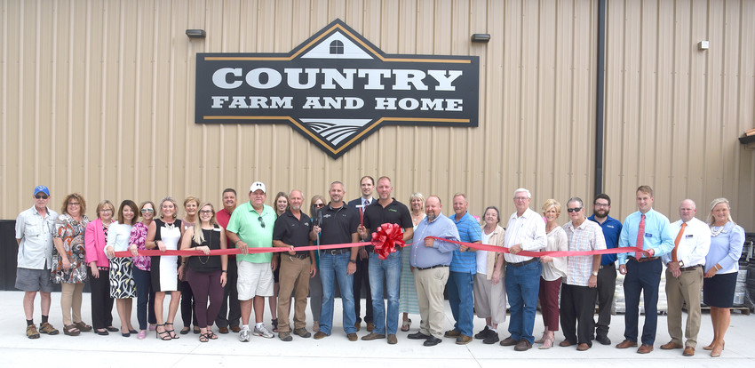 Country Farm and Home celebrates its ribbon cutting. From left: Bob Shartrand, Overton Co. Chamber ambassador; Rita Reagan Underhill, director of marketing and tourism Overton Co. Chamber; Dianne Callahan, Putnam Co. VP organization development; Amy Grissom, Putnam Co. Chamber ambassador; Toni Evans, Putnam Co. Chamber ambassador; Nicole Cooper, Overton Co. Chamber ambassador; Wanda Krantz, Overton Co. Chamber ambassador; Ashlyn Poplin Hall, Putnam Co. Chamber ambassador; Ken Dodson, Overton Co. Chamber ambassador; Billie Phipps, Overton Co. Commissioner; Jennifer Wheeler, Putnam Co. Chamber membership coordinator; Chris Ballinger, store manager; Tracy Hughes, Putnam Co. Chamber ambassador; John Scott, store owner; Ian Robson, Putnam Co. Chamber ambassador; Rik Richter, store manager; Kathy Dunn, Putnam Co. Chamber ambassador; Ben Danner, Overton Co. mayor; Lee Richards, Overton Co. commissioner; Ann Talley, wife of Overton Co. commissioner; Phillip Talley, Overton Co. commissioner; Erin Montgomery, Overton Co. Chamber ambassador; Greg McDonald, executive director Overton Co Chamber; Brandon LaDuke, Overton Co. Chamber ambassador; Dylan Richards, Overton Co. Chamber ambassador; Michael Austin, Overton Co. Chamber ambassador and Leslie Loftis, Chamber ambassador.