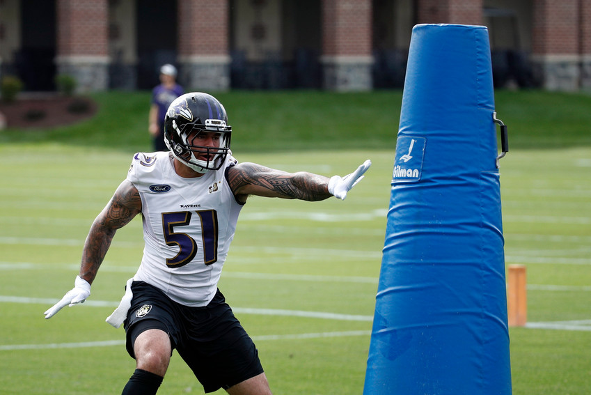 In this June 13 file photo, Baltimore Ravens linebacker Kamalei Correa runs a drill during an NFL football practice at the team's headquarters in Owings Mills, Md. The Tennessee Titans have acquired linebacker Kamalei Correa from the Baltimore Ravens for an undisclosed draft pick. The Titans announced the trade Tuesday
