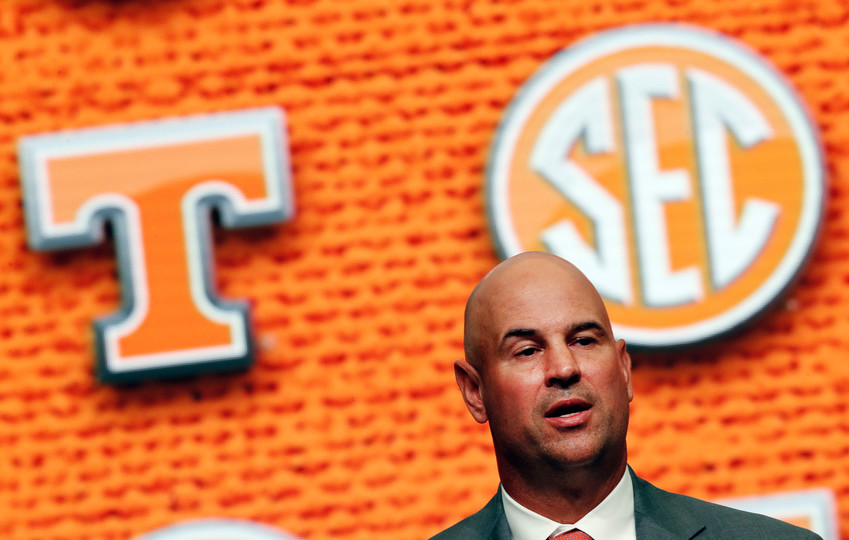 In this July 18, 2018, file photo, Tennessee NCAA college football head coach Jeremy Pruitt speaks during Southeastern Conference Media Days in Atlanta. Tennessee's quarterback situation remains a mystery less than a week before the first game of Pruitt's coaching tenure.