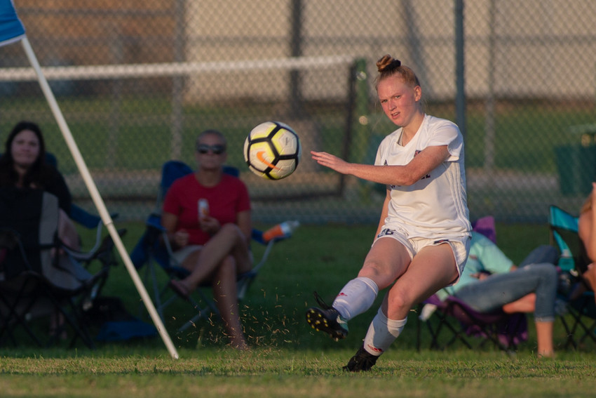 Kayla Lynch sends the ball to a teammate during the second half of play Tuesday.