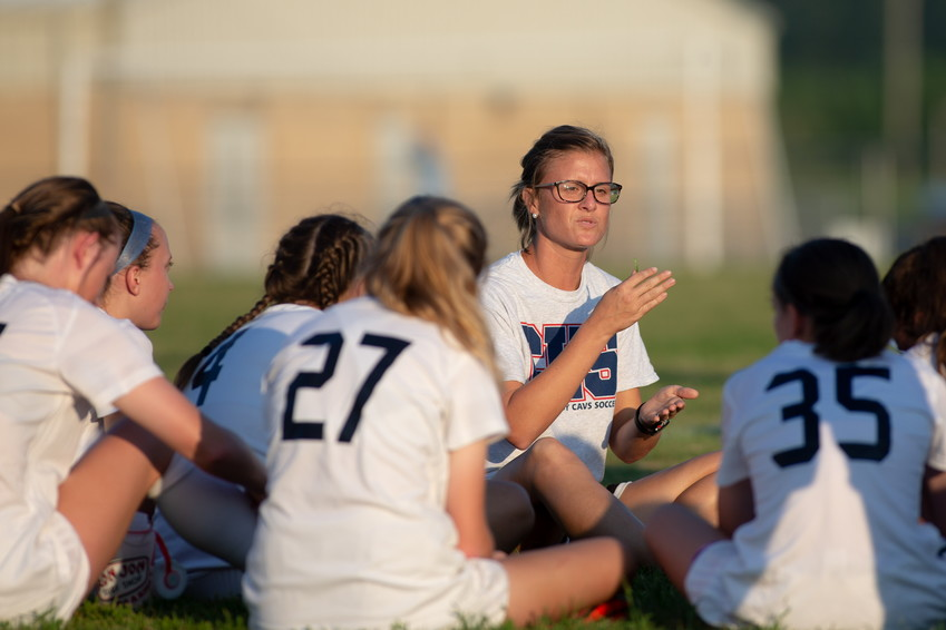 Cookeville coach Lauren Metts (center) talks to her team during halftime.