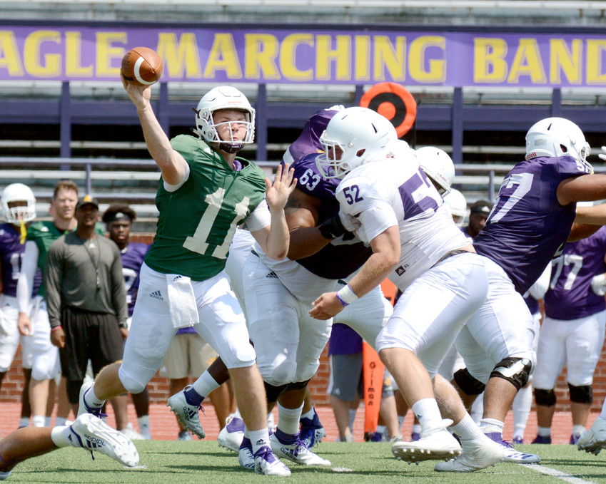 Tennessee Tech true freshman quarterback Bailey Fisher, left, fires a pass during a scrimmage in early August at TTU.