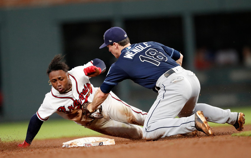 Atlanta Braves' Ozzie Albies (1) is tagged out at second base by Tampa Bay Rays second baseman Joey Wendle (18) as he tries to stretch a single in the fifth inning of a baseball game Wednesday, Aug. 29, 2018, in Atlanta. (AP Photo/John Bazemore)