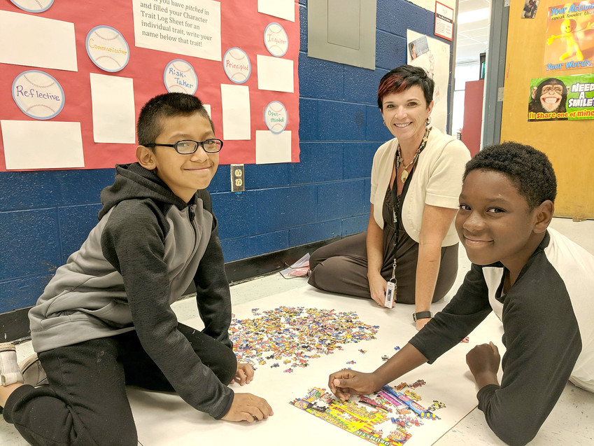 "At Avery Trace Middle School, Virgilio Pascual, left, and Roy Baker gear up for ""Brain Games"" with Mrs. Crabtree as part of last year's LEAPs program."