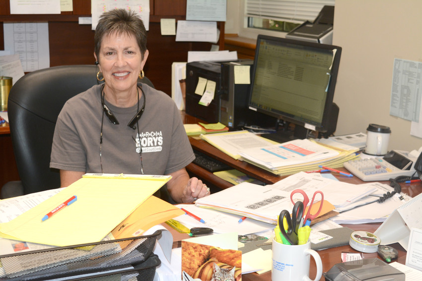 Marcia Borys sits at the desk that she's practically called home since serving 16 years as the Putnam County Circuit Court Clerk.