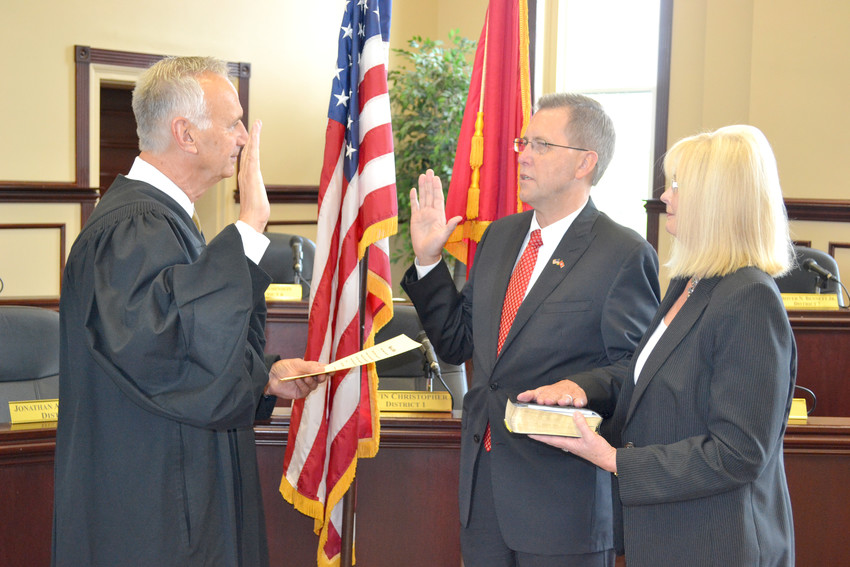 Judge David Patterson, left, swears in Putnam County Executive Randy Porter as his wife, Melanie, looks on.