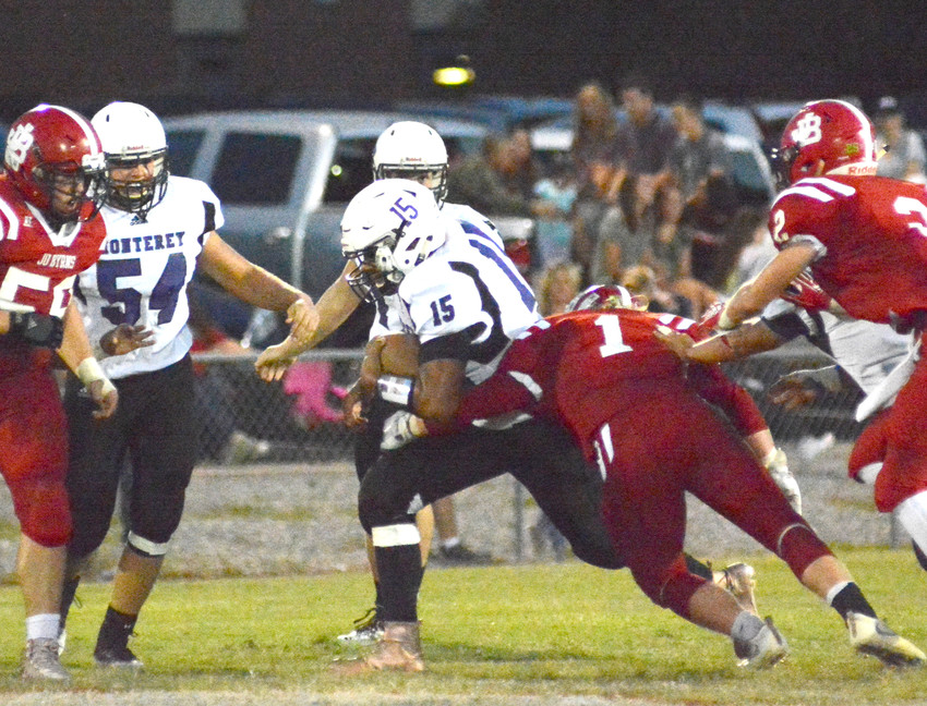 Tailback Anthony Soberanis drives through the Jo Byrns' defense during action Friday night.