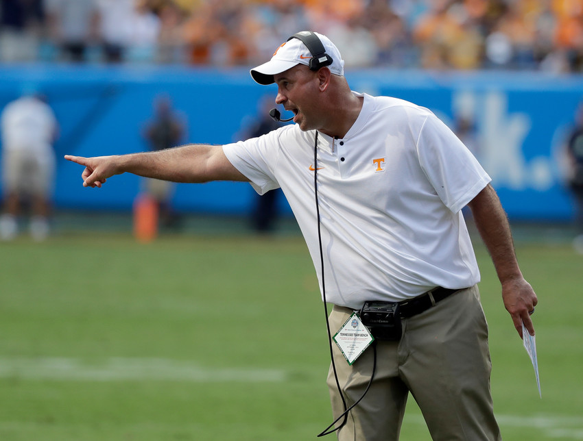 Tennessee head coach Jeremy Pruitt directs his team against West Virginia in the first half of a game in Charlotte, N.C., Sept. 1.