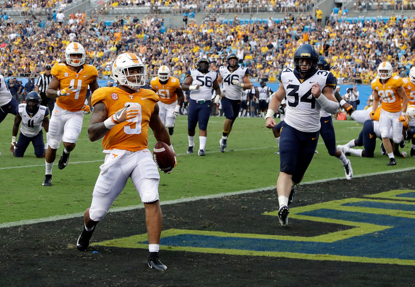 Tennessee's Tim Jordan (9) runs into the end zone past West Virginia's Shea Campbell (34) for a touchdown in the second half of a game in Charlotte, N.C., Sept. 1.