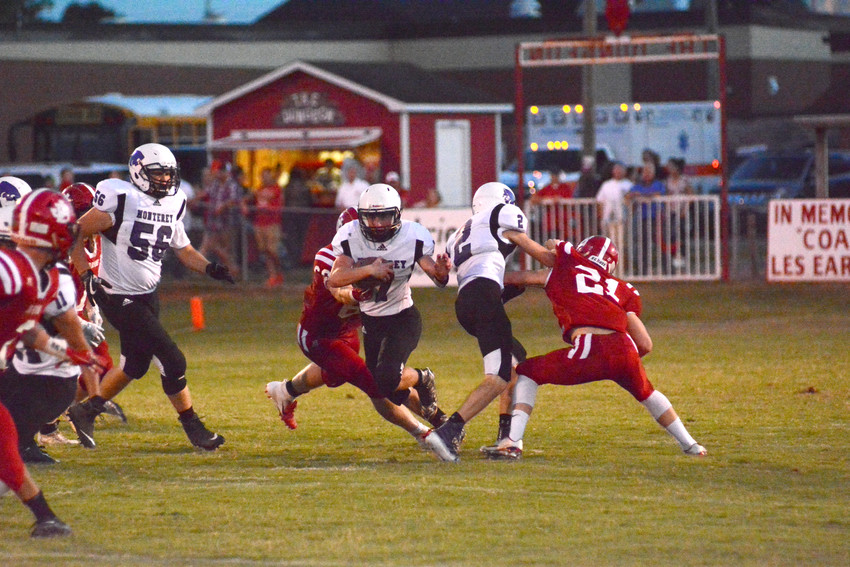 Monterey's Jordan Key, center, looks for running room against Jo Byrns last Friday in Cedar Hills.