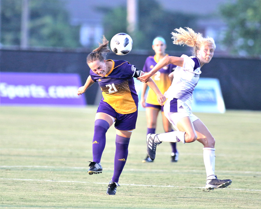 Tennessee Tech's Tina Marolt, left, battles with a North Alabama player for a ball during the Golden Eagles' 4-0 win in late August at TTU.