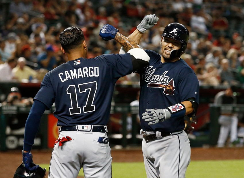 Atlanta Braves' Kurt Suzuki, right, celebrates his two-run home run against the Arizona Diamondbacks with Johan Camargo (17) during the fourth inning of a baseball game Thursday, Sept. 6, 2018, in Phoenix. (AP Photo/Ross D. Franklin)