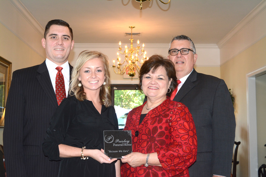 Bryant Presley, the Presley Funeral Home director, has announced a partnership with Carriage Services, Inc. Presley said the partnership will better serve families and the funeral home's employees. From left are Seth Presley, Alie Presley, Lynne Presley and Bryant.