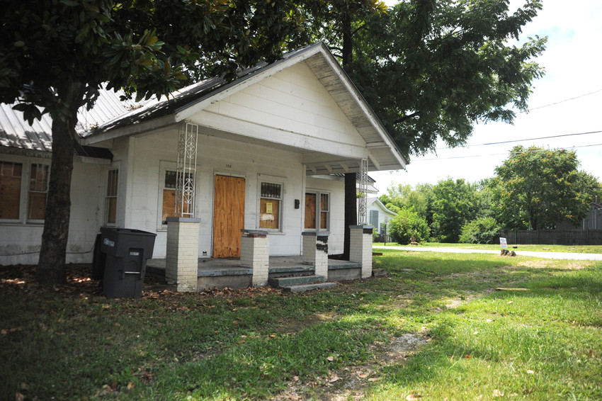 The condemned old home of Byron Looper has been approved by the city council to be part of an RAO District designed to encourage redevelopment.