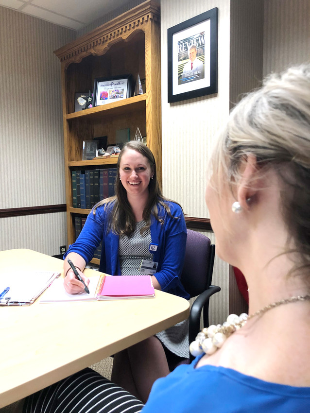 CRMC's new genetic counselor Ashley Cohen holds a conference with a client. CRMC has offered genetic testing for years, but Cohen is the hospital's first genetic counselor.