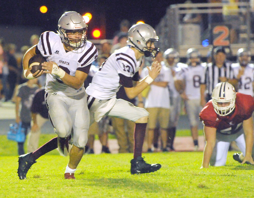 White County's Allen Shoupe, left, runs during the Warriors' 55-0 loss to the Cookeville Cavaliers on Friday at CHS.