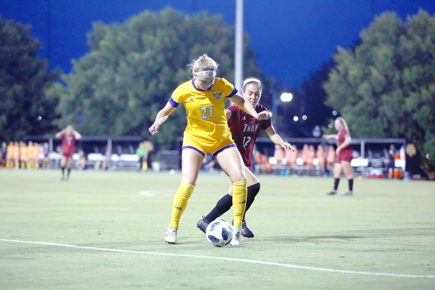 Tennessee Tech's Kendall Powell, left, battles for possession during the Golden Eagles' 2-1 win over Troy on Friday at TTU.