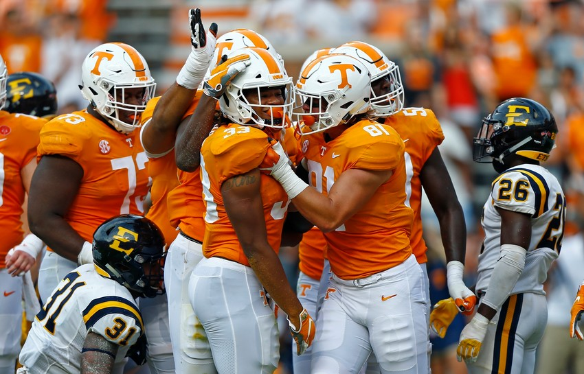 Tennessee running back Jeremy Banks (33) is congratulated by tight end Austin Pope (81) and others after scoring a touchdown in the first half of an NCAA college football game against East Tennessee State University Saturday, Sept. 8, 2018, in Knoxville, Tenn. (AP Photo/Wade Payne)