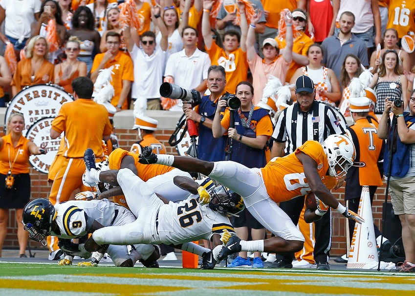 Tennessee wide receiver Josh Palmer (84) dives into the end zone for a touchdown as he's hit by East Tennessee State University's Artevius Smith (26) and Karon Delince (9) in the first half of an NCAA college football game Saturday, Sept. 8, 2018, in Knoxville, Tenn. (AP Photo/Wade Payne)