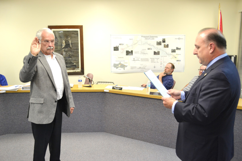 State Senator Paul Bailey, right, swears in Monterey Mayor Bill Wiggins for a new term.