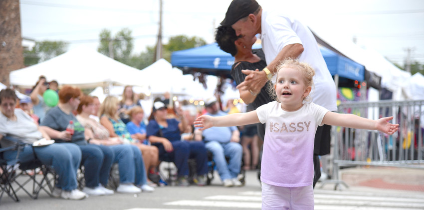 "With her sequined ""#SASSY"" shirt, Emma Cercone, 3, of Cookeville, stole the show in front of CityScape's big stage Saturday evening during the annual Fall FunFest in Cookeville. She pirouettes around Don and Teri Locke of Shelbyville, who have become regulars at the signature event that kicks off fall in the Upper Cumberland."