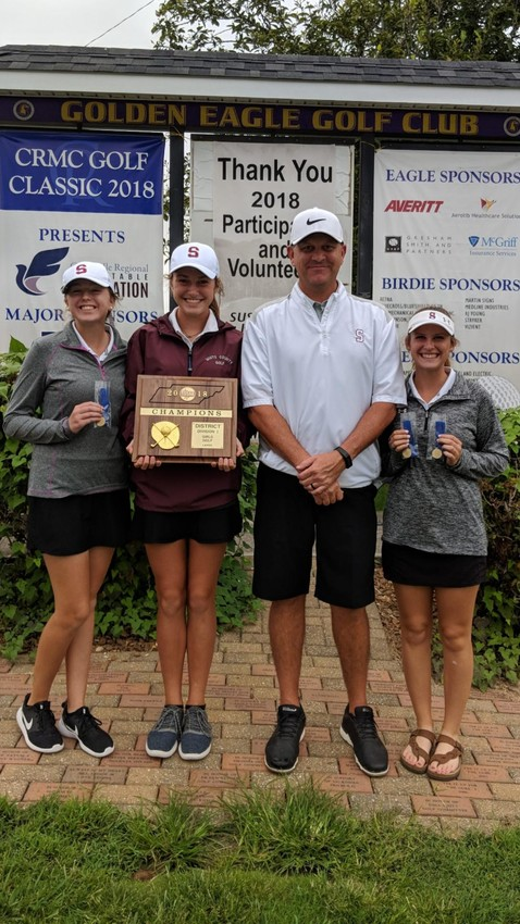 The White County Warriorettes won the girls' overall title. The team includes, from left: Ansley Phifer, Morgan Quick, coach Eric Mitchell and Mackenzie Morton