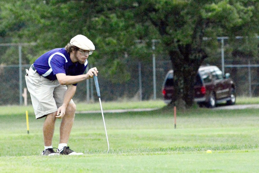 Issac Howard lines up his putt. Howard shot 48 for the Wildcats.
