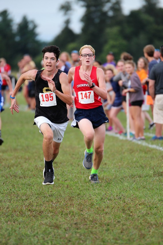 Cookeville's Ty Young, right, drives to the finish line.