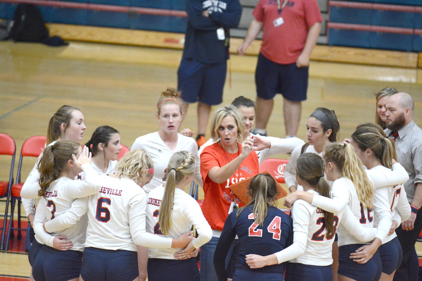 Head coach Jami Cherry, center, speaks to her team during a break in the action.