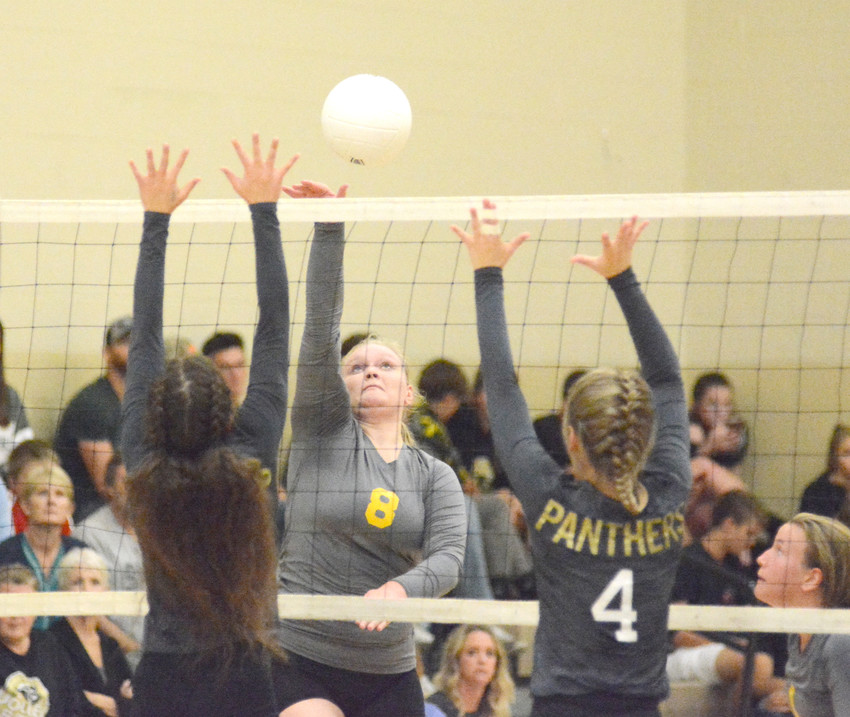 Upperman High School's Katie Taylor, center, fires a shot through two Stone Memorial defenders during action Tuesday.