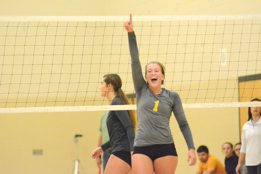 Addie Adams celebrates after the Lady Bees score against Stone Memorial.