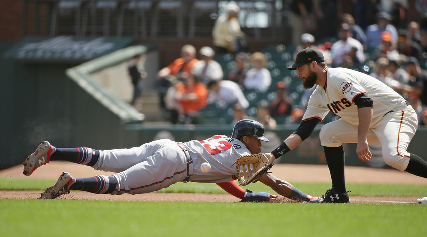 Atlanta Braves' Ronald Acuna Jr. gets picked off at first base as San Francisco Giants first baseman Brandon Belt waits for the throw from pitcher Derek Holland in the first inning of a baseball game Wednesday, Sept. 12, 2018, in San Francisco. (AP Photo/Eric Risberg)