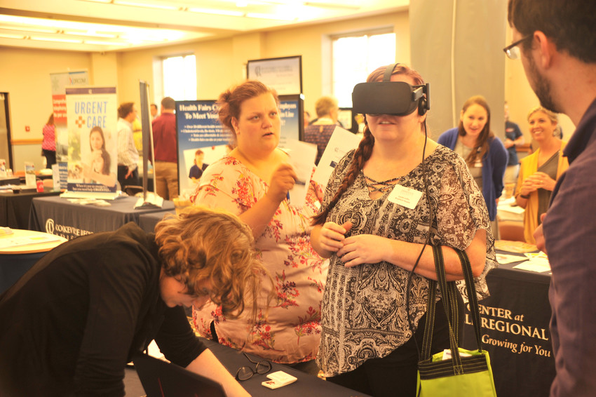 Lynda Loftis tried out the Oculus Rift virtual reality program at the iCube booth at Bizapalooza