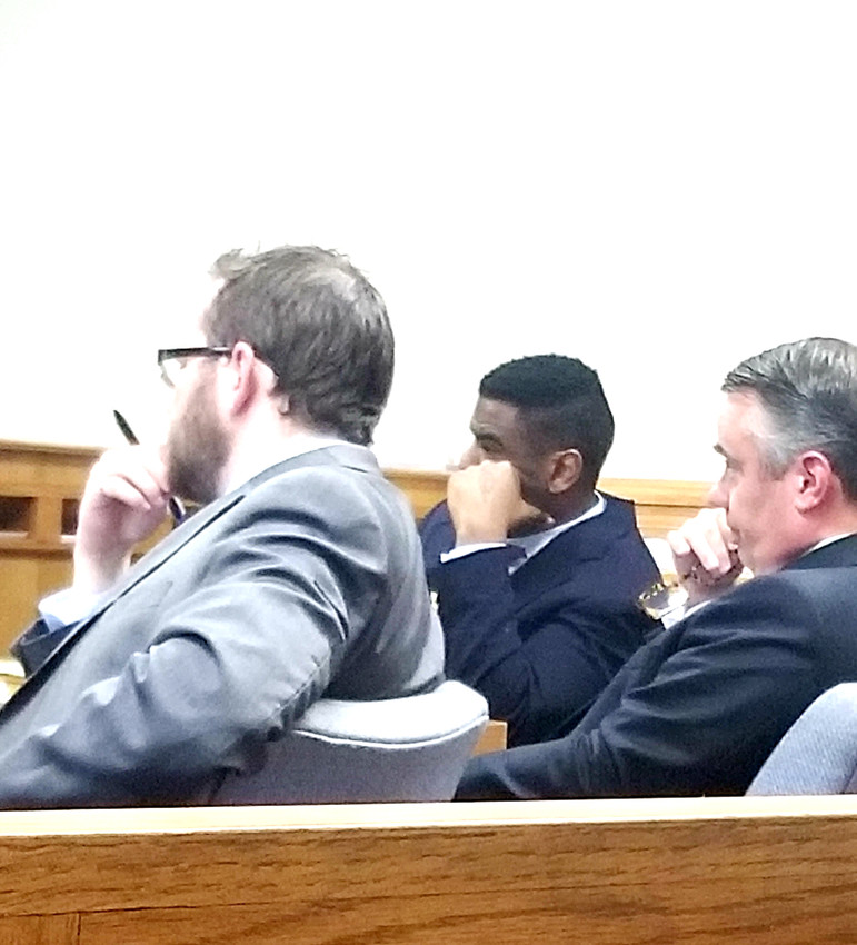 Smith, center, sits with  defense attorneys Jon Hatfield, left, and and Craig Fickling, right.
