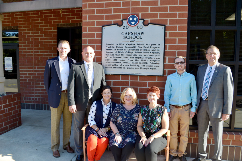 Commemorating the installation of a historical marker at Capshaw Elementary School are, from left, State Rep. Ryan Williams, Director of Schools Jerry Boyd, Assistant Principal Diana Wood, Principal Kim Wright, PTO President Stacey Hardison, historical consultant Carver Moore and Putnam County Executive Randy Porter.