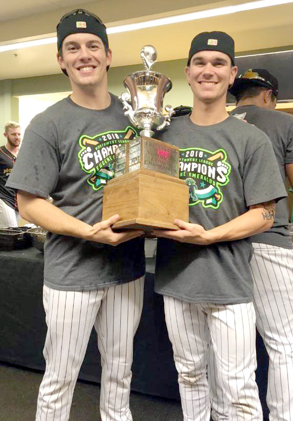 Former Tennessee Tech baseball standouts Brennon Kaleiwahea (left) and Ethan Roberts hoist the Northwest League Championship trophy after the Eugene Emeralds defeated the Spokane Indians last week in the title series.