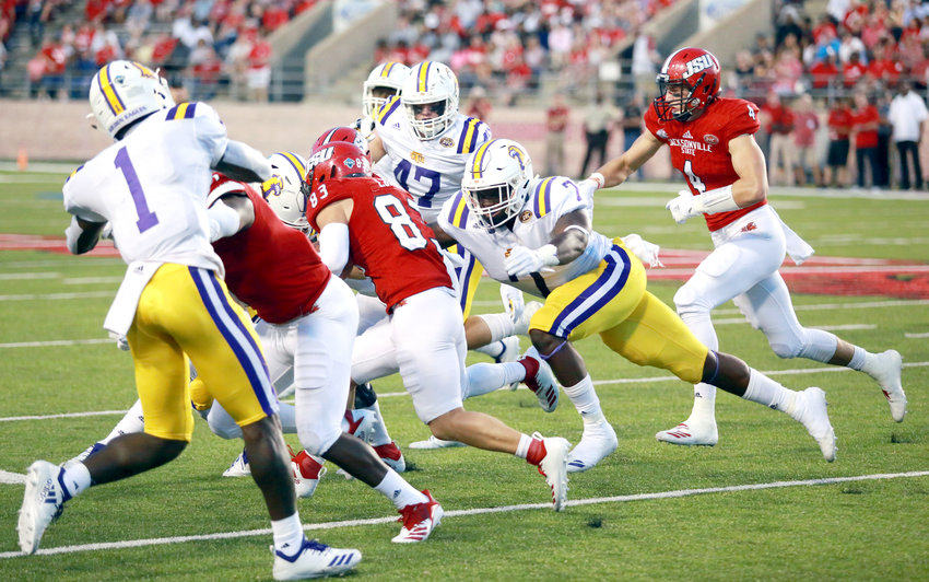 The Tennessee Tech defense brings down a Jacksonville State University tailback during action Saturday.