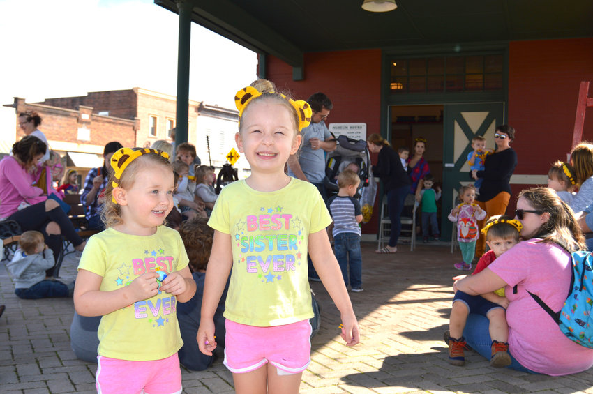 Kailyn Brock, 2, and Kaylee Brock, 4, wear their Daniel Tiger ears during Train Tales at the Cookeville Depot Museum. The ears were donated by WCTE.