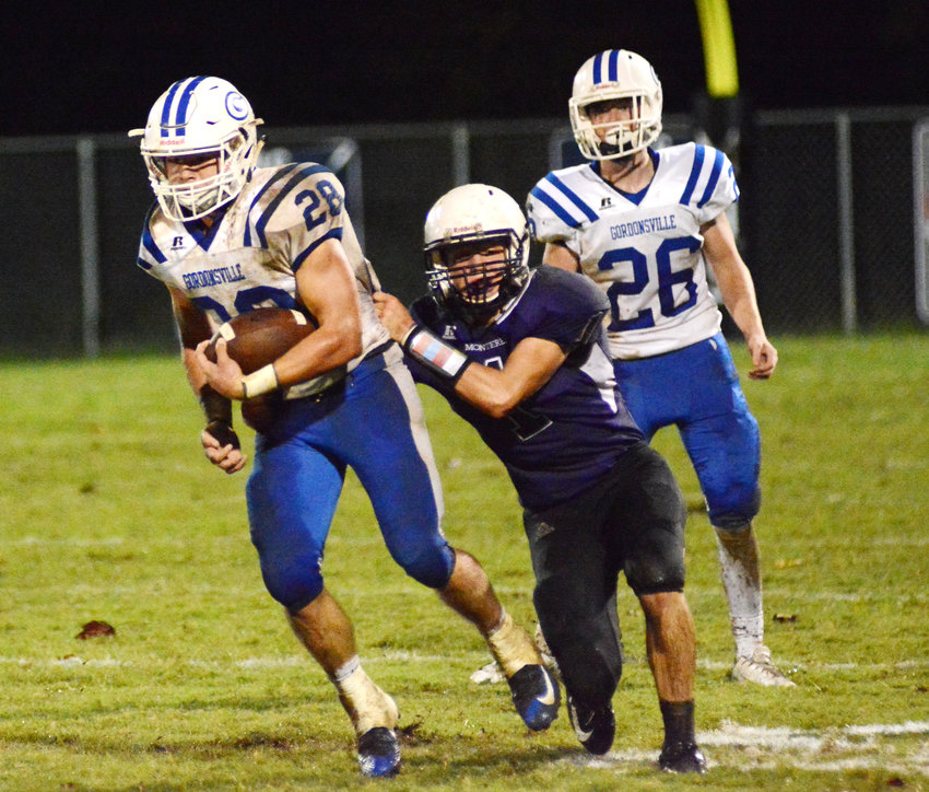Monterey's Paxton Payne, right, grabs hold of Gordonsville's Braxton Givens during action Friday night in Monterey.