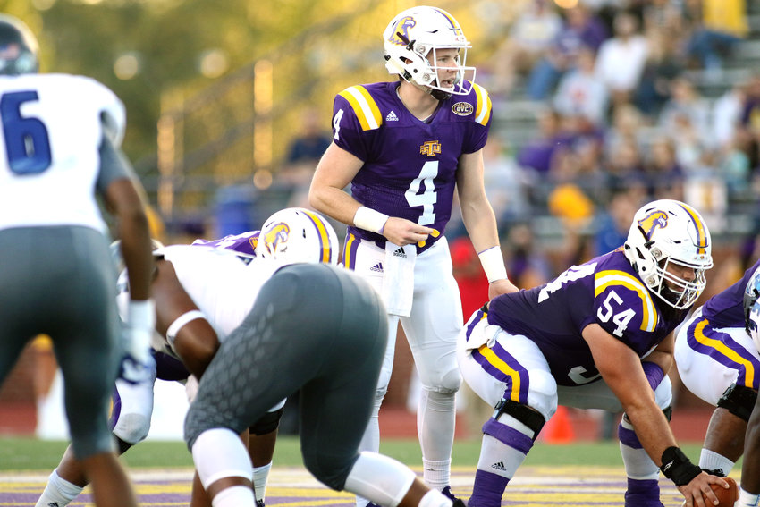 Tennessee Tech quarterback Bailey Fisher (4) prepares to take a snap during the Golden Eagles' 52-38 loss to Eastern Illinois Saturday at Tucker Stadium.