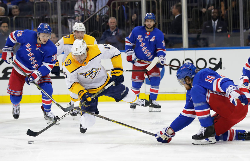 Nashville Predators' Craig Smith (15) fights for control of the puck with New York Rangers' Marc Staal (18) during the first period of an NHL hockey game Thursday, Oct. 4, 2018, in New York. (AP Photo/Frank Franklin II)