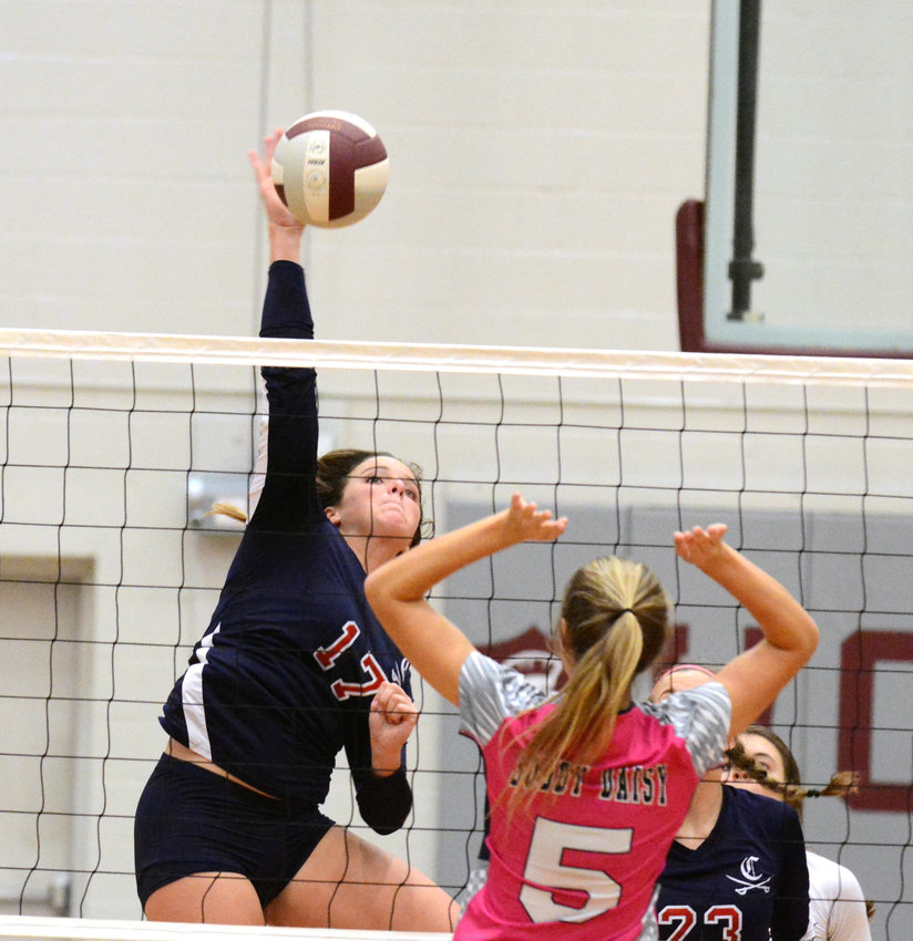 Cookeville middle hitter and District 6-AAA Tournament MVP Bailey Turnbow delivers a kill during the District 6-AAA Championship Tuesday at White County High School.