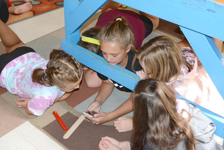 A group of girls enjoyed each other's company at the Fall Camp at Cane Creek Recreation Center Tuesday morning.