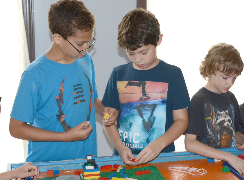 Lego blocks provide lots of fun for kids at the Fall Camp at Cane Creek Recreation Center. From left, Braydon Redmon, Cameron Birdwell and Patrick Venters work together to create a building.