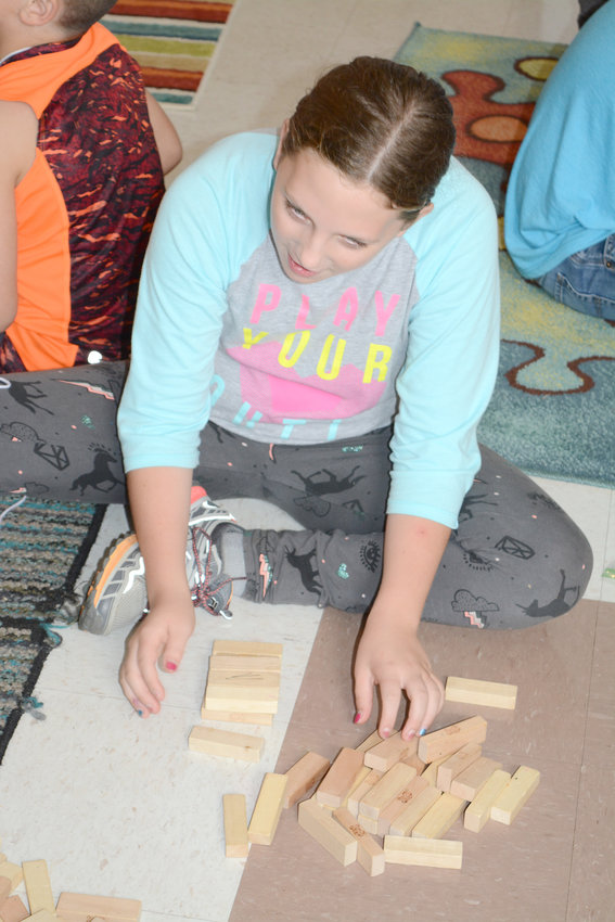 Meagan Lafever works on her wooden block creation at the Fall Camp.