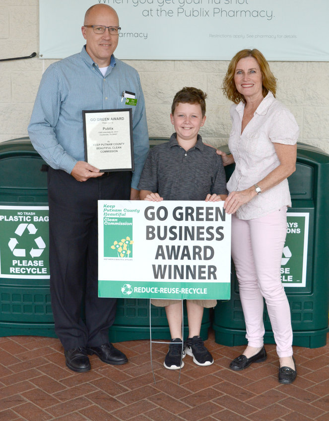 Publix received the Putnam County Clean Commission's Go Green award for October. Cookeville's Publix offers recycling bins for styrofoam, cardboard and plastic bags. From left is store manager Dan Ratchup, Yoel Reyes, and Yoel's mom, Shannon Reese, the executive coordinator for the Putnam County clean commission.