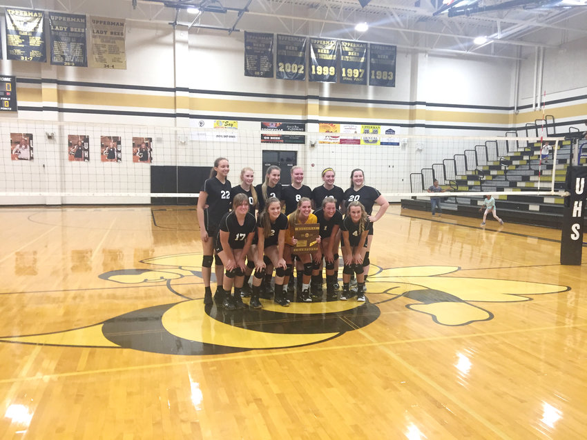 The Upperman High School volleyball team poses after winning the Region 4-AA Tournament Tuesday night at UHS.